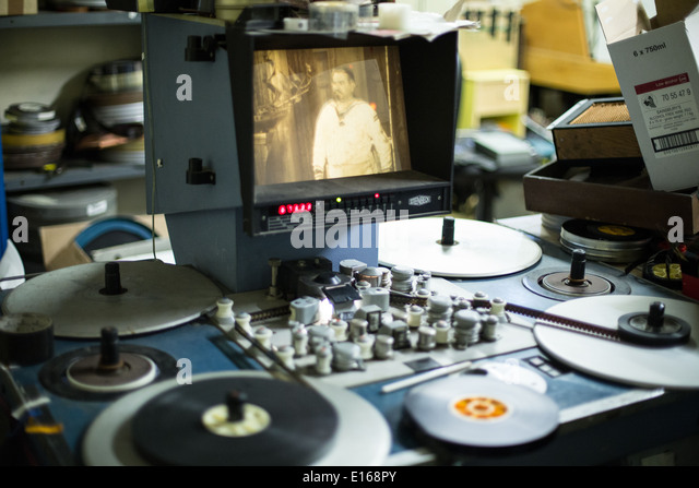 Steenbeck editing machine playing old black and white film - Stock Image