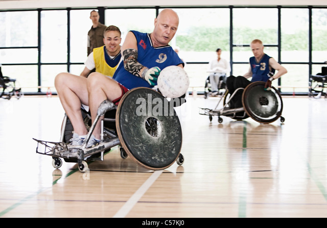 Para rugby players playing rugby - Stock Image