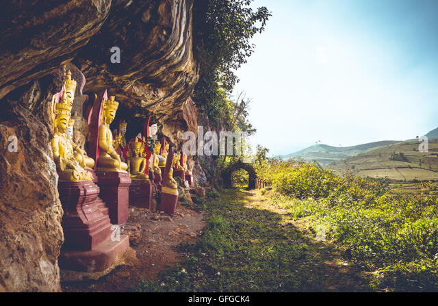 Statues of Buddha in caves in Shan State, Myanmar. - Stock Image
