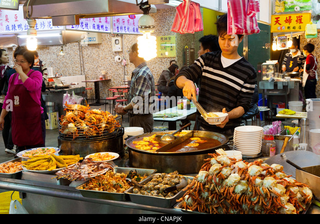 Seafood snacks stall in Shilin Night Market Taipei Taiwan. JMH5987 - Stock Image