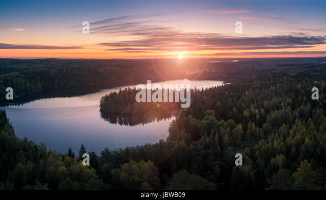 Scenic landscape with sunrise and lake at autumn in national park - Stock Image