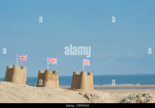 Union Jack flags in sandcastles on a sand dune. Wells next the sea. Norfolk, England - Stock-Bilder