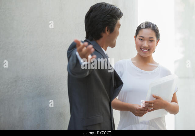 Estate agent showing buyer around - Stock Image