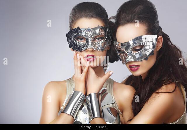 Masquerade. Artistic Women in Fancy Bright Glasses - Stock Image
