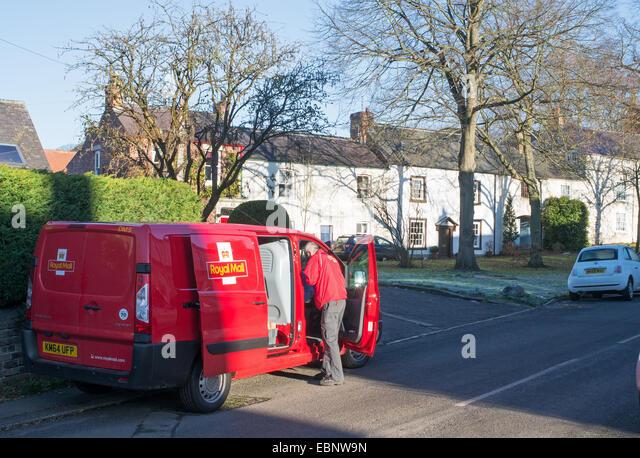 Royal Mail van and postman delivering at Shincliffe village, County Durham England, UK - Stock Image
