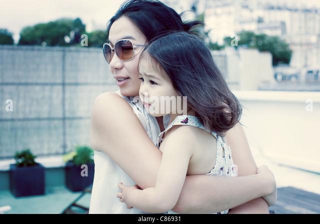 Mother holding little girl - Stock Image