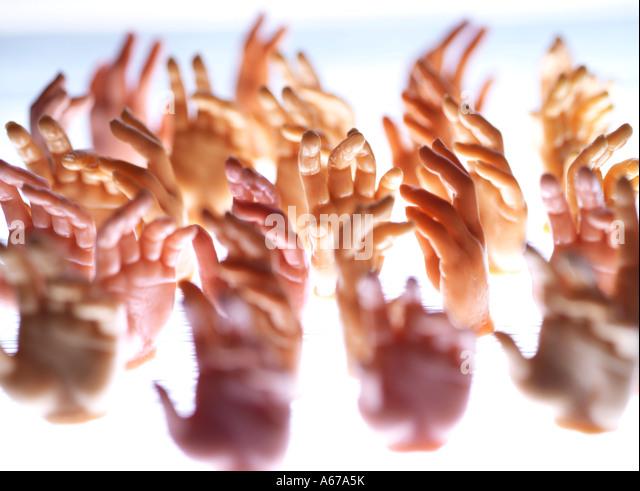hands reaching out - Stock-Bilder