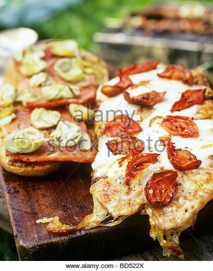 Pizza with chili peppers and with artichokes - Stock Image