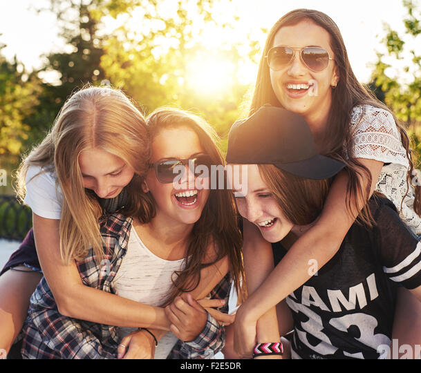 Group of friends laughing and having fun - Stock Image