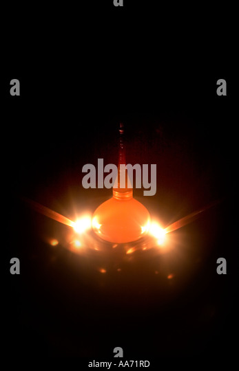 A shaft with a titanium seed crystal being lowered into a crucible of molten titanium at 1300 degrees centigrade - Stock Image