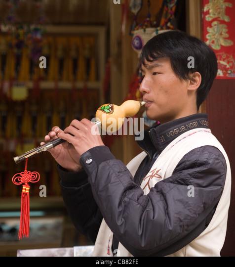 China Yunnan Lijiang musician - Stock-Bilder