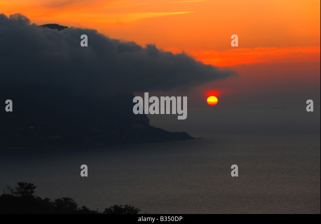 Sunset A picturesque sunset with fantastic foggy under mountain - Stock-Bilder