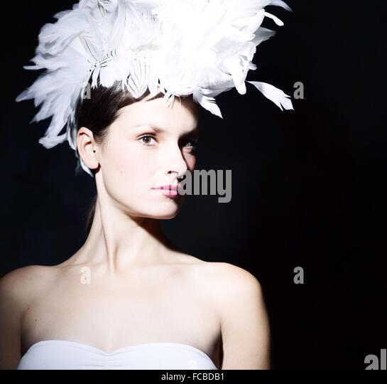 Portrait Of A Beautiful Young Woman Over Black Background - Stock-Bilder