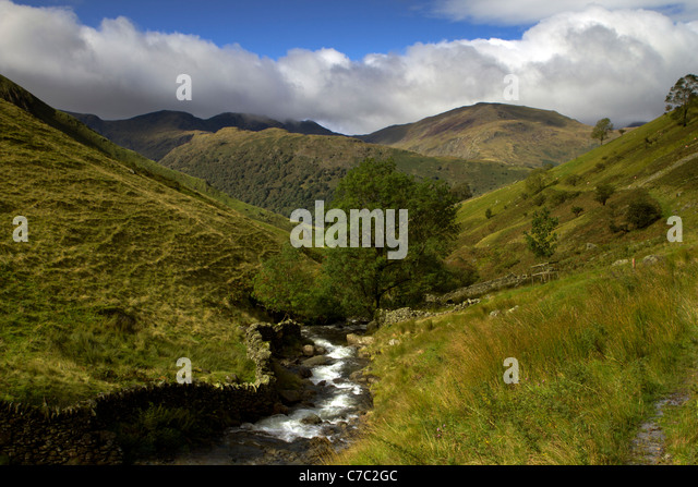 Hayswater Gill towards the Helvellyn range of mountains, Lake District, Cumbria - Stock Image