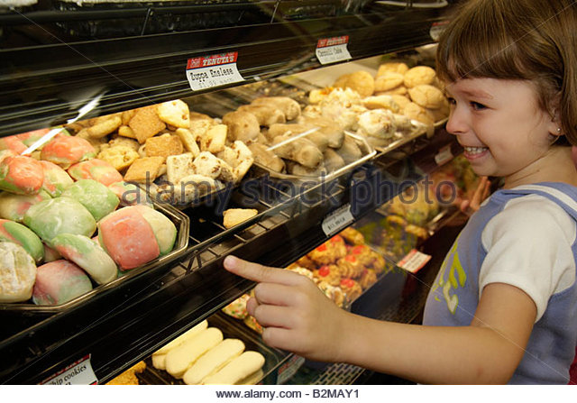 Wisconsin Kenosha Tenuta's Delicatessen Liquors and Wines girl tray food bakery dessert Italian market pastry - Stock Image