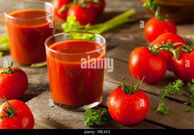 Raw Organic Tomato Juice with Parsley and Celery - Stock Image