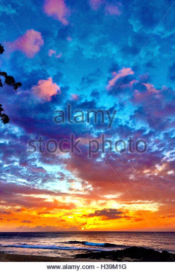 vibrant sunset scenic on the beach - Stock Image