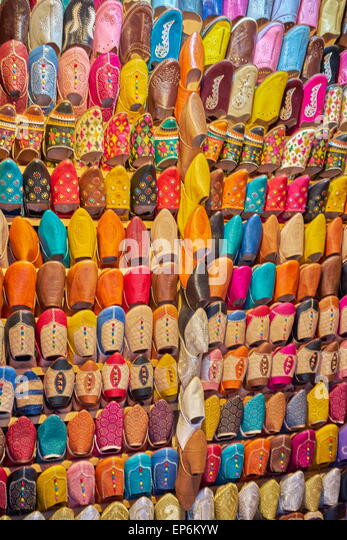 Shoe store. Babouches, brightly coloured traditional Moroccan slippers. Morocco - Stock Image