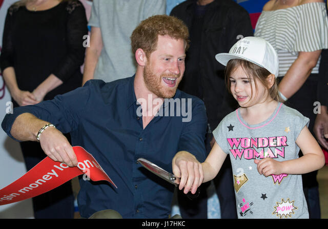London, UK. 19th Apr, 2017. Prince Harry enlists the help of Melissa Howse, 5, to cut the ribbon. Prince Harry opens - Stock Image