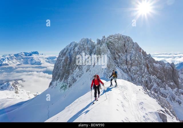 two men ski touring in the mountains, Salzburg, Austria - Stock Image