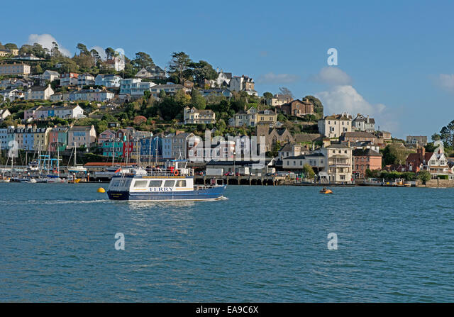 Dartmouth/Kingwear Ferry cruising along the River Dart  with a landscape view of  Kingswear in the background, South - Stock-Bilder