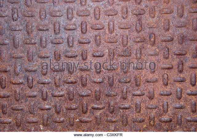 Oxidized piece of old metal. Corroded texture - Stock Image