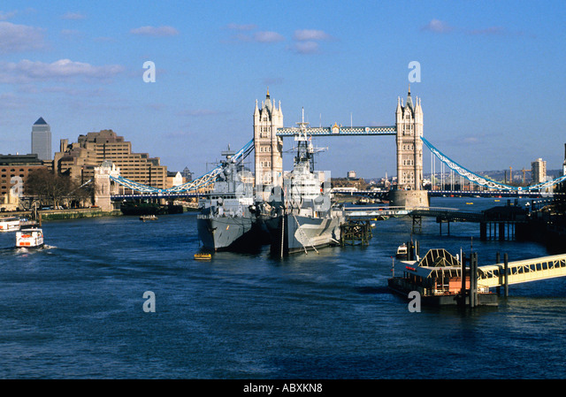 Europe England London Great Britain United Kingdom UK Tower Bridge and Two Warships - Stock Image