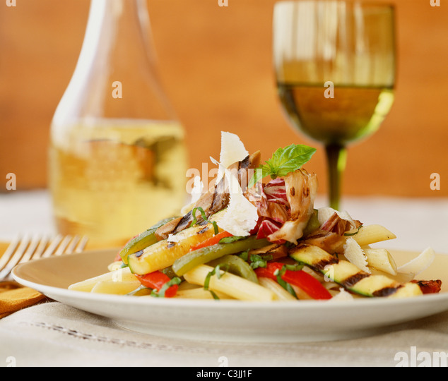 Pasta Primavera and wine. - Stock Image
