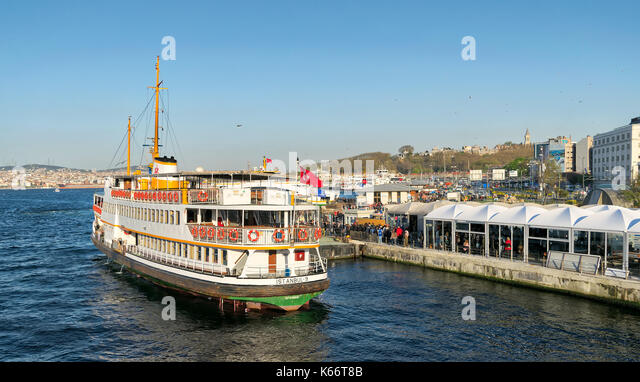 Istanbul, Turkey - April 25, 2017: Passengers Loading into local ferry in Eminonu ferry terminal before sunset, - Stock Image