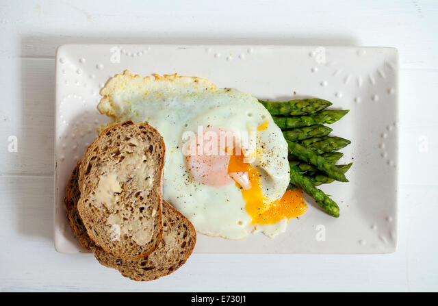Egg with asparagus and bread - Stock Image