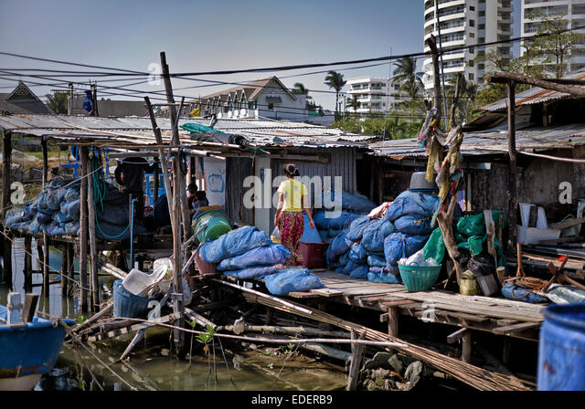 Thailand slum dwelling overlooked by high rise hotel block producing a scene of contrasting lifestyles. Thailand - Stock Image