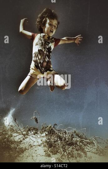 Boy jumping - Stock-Bilder