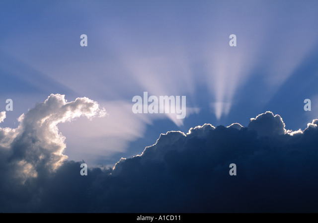 Sun rays through clouds - Stock Image