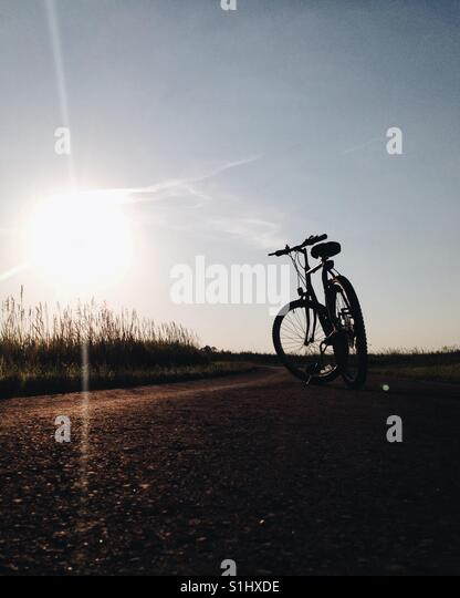Bike ride at sunset - Stock-Bilder