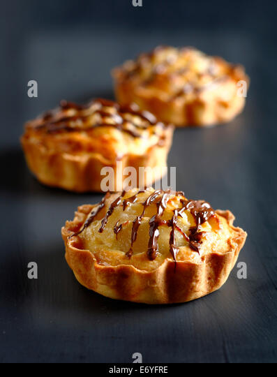 Pear-choclate tartlets - Stock Image