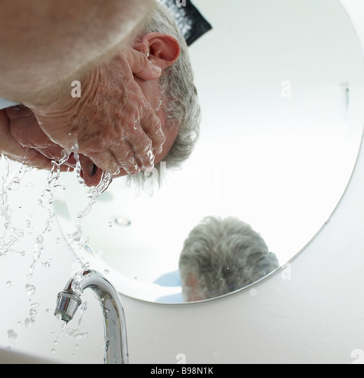 mature man washing face - Stock-Bilder