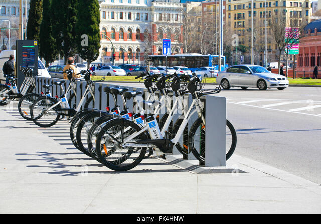 Row of for hire BiciMad electric bikes in their charging stands. Madrid, Spain - Stock Image