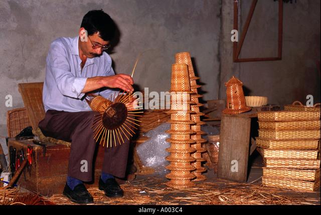 Basket weaver at work Camacha Madeira - Stock Image