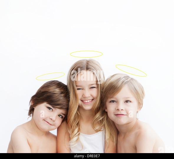 Portrait of siblings with halos - Stock-Bilder
