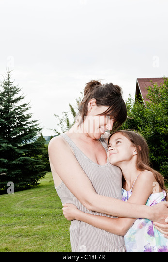 Mother and daughter hug - Stock Image