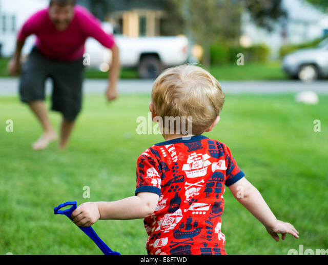 Father and son playing in garden - Stock Image