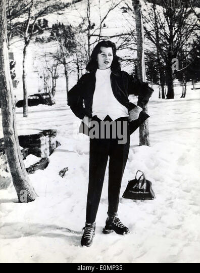 Jan 31, 1956 - Megeve, France - RITA HAYWORTH, in a complete ski suit, is in the French Alps to do a little skiing - Stock Image