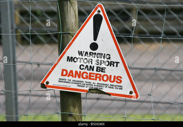 Motor sport can be dangerous sign post - Stock Image