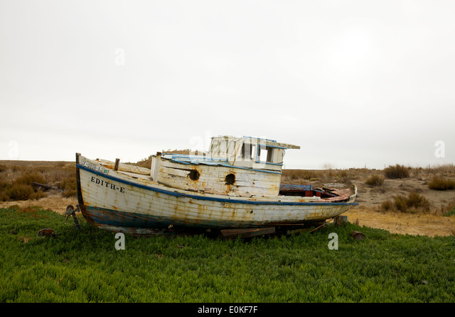 The Edith-E, a boat sits ashore in the Port Sonoma Marina in Petaluma, California. - Stock Image