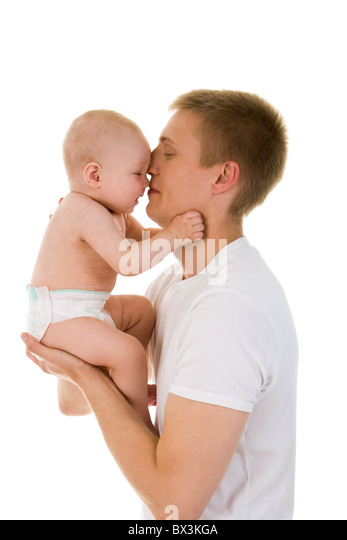Portrait of loving father and his baby cuddling - Stock Image