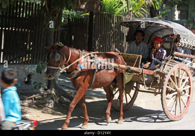 Ahorse carriage is pictured in Mandalay (Amarapura Township), Myanmar, 25 October 2012. Photo: Rolf Zimmermann - Stock-Bilder