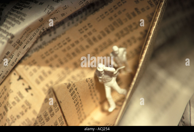 Two men on paper boat made from a newspaper page with stock exchange quotations. - Stock-Bilder