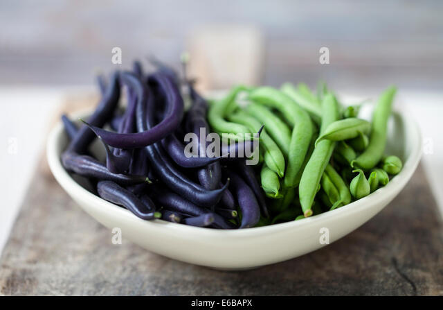 Purple and green dwarf beans - Stock Image