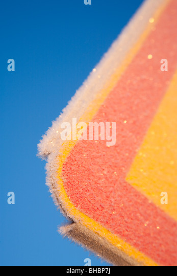 Colorful metal covered with frost - Stock Image
