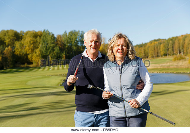 Sweden, Sodermanland, Portrait of senior man and mature woman at golf course - Stock Image